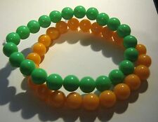 2x Bracelets wonderful beaded elasticated green & orange 80's style fab fun!