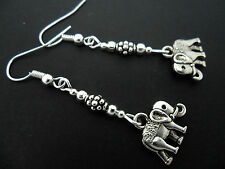 A PAIR OF  TIBETAN SILVER DANGLY ELEPHANT  EARRINGS. NEW.