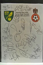 An A4 white card with the Norwich City Badge. Signed by19 players on 28.07.2014