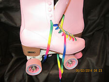 Women Sz  From 7 TO 9, heel to toe is 9 1/2 /   Pink & White Roller Skates