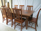 Solid hardwood dining table and 8 solid chairs. table and chairs
