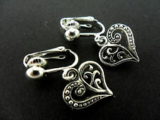 A PAIR OF DANGLY TIBETAN SILVER   HEART  CLIP ON EARRINGS.  NEW.