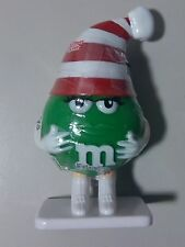 Green M&M With Red And White Striped Santa Hat Candy Filled Figurine