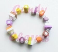 CANDY CHARMS DOLLY MIXTURE ELASTICATED BRACELET. 6x10MM BEADS CLEAR BEADS