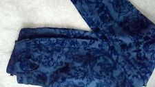 Brand new navy skinny trousers with self colour floral velvet flock