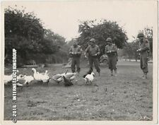 ORIGINAL WWII PHOTO OF U.S. SOLDIERS FEEDING DUCKS FOR EVACUATED FARMERS -1944