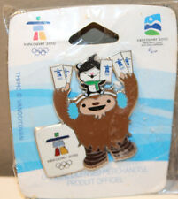 2010 Quatchi Miga Holding Tickets Vancouver Winter Olympics Collectible Pin