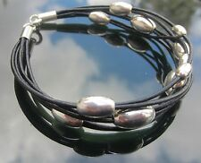 Black Leather Cord Bracelet with Oval Beads 925 Sterling Silver Ends and Clasp