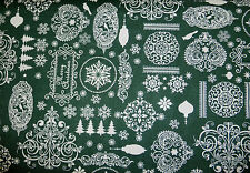 Fat quarter in cotton with filigree Christmas designs in white on green