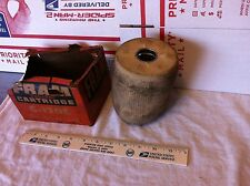 Oil filter.  Fram, C-120E/676575,   NOS and badly soiled.    Item:  1848