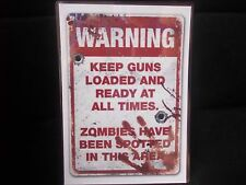 FUNNY A5 LAMINATED SIGN  WARNING KEEP GUN LOADED AT ALL TIMES ZOMBIES SPOTTED