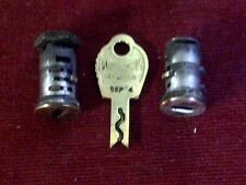 PAIR OF BRASS LOCK CYLINDERS AND A MATCHING KEY FOR DUNCAN MILLER 60s