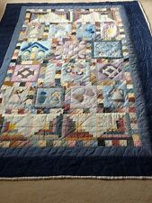 """A lovely Quilt that is approximately 85"""" x 61"""""""