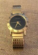 vintage goldtone women's Geneva quartz roman numeral watch with Hadley Roma band