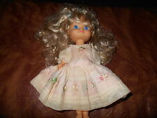 "1994 Cititoy 9"" Hard Bodied w blue eyes and blond curly hair in pink dress"