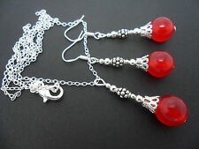 A RED JADE BEAD NECKLACE AND EARRING SET  WITH 925 SILVER HOOKS.