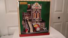 CHRISTMAS VILLAGE FIRE HOUSE #12. BY LEMAX HAS FIRE TRUCK PARKED IN DOOR WAY