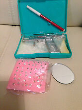 Body piercing set (gun,studs,ends,mirror,case)