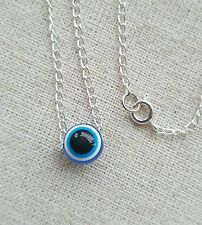 Evil eye protection necklace. Blue bead pendant. Simple talisman. Fashion.