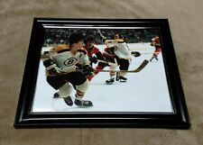 Philadelphia Flyers Bobby Clarke vs Bobby Orr Boston Bruins 8x10 Framed Photo