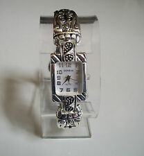 Designer western style silver finish with black leather band watch
