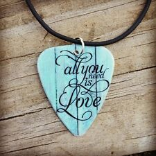 All you need is LOVE guitar pick on black necklace with turquoise quote jewelry