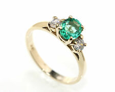 Fine Colombian Emerald Oval Faceted set in a 14kt Yellow Gold Ring with CZ New!