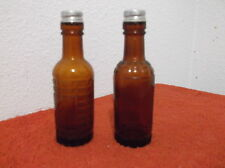 VINTAGE BROWN GLASS BOTTLE SHAPED SALT & PEPPER SHAKERS .