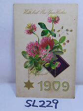 VINTAGE POSTCARD POSTED STAMP 1909 A HAPPY NEW YEAR FLOWERS-STAR OF DAVID BOOK