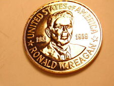 Gold colored commemorative medal honoring President Regan