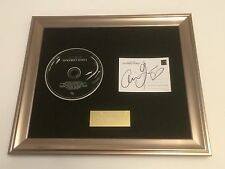SIGNED/AUTOGRAPHED ARIANA GRANDE - DANGEROUS WOMAN FRAMED CD PRESENTATION.