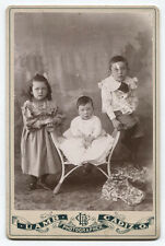 CABINET CARD THREE YOUNG SIBLINGS. NOT A SMILING FACE IN THE BUNCH. CADIZ, OHIO.