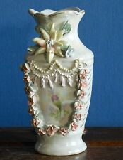 Elaborate lustre finish vase with sprigged applied flowers and strings of pearls