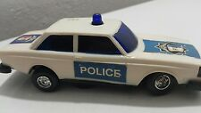 VINTAGE POLICE P.D VOLVO WIND UP CLOCKWORK TOY CAR WITH SIREN PLASTIC WORKS RARE
