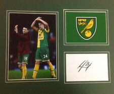 A 12 x 10 inch mounted display personally signed by Ryan Bennett of Norwich City