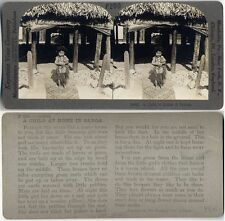 A CHILD AT HOME IN SAMOA HOUSES W/ GRASS ROOFS STEREOVIEW