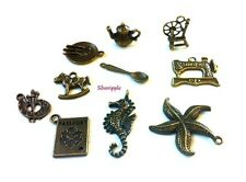 10 CHARM PENDANTS spinning wheel,teapot,spoon,plate,passport,starfish,sewing