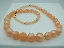 VINTAGE MONET SIGNED PEACH LUCITE GRADUATED MOON GLOW BEAD NECKLACE 30""