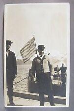 circa 1910 MAN SMOKING PIPE ON SHIP American Flag real photo postcard RPPC