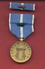 One Korean War Service Award medal with Oak leave device with ribbon bar
