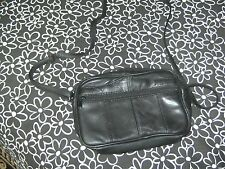small black leather travel bag