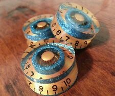3 Guitar speed volume / tone knobs.. Turquoise Fk/Gold. JAT CUSTOM GUITAR PARTS