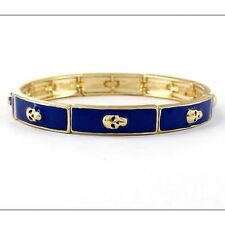 Blue Enamel Stretch Bracelet with Gold Toned Skulls