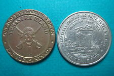 TREASURE ISLAND, RIO HOTEL CASINO  $1  GAMING TOKENs, 1989, Las Vegas, Nevada