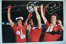 A 12 x 8 inch photo personally signed by Phil Neal playing for Liverpool. (1).