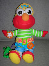 TYCO 1997    DRESS UP PAL  ELMO   CRINKLE BUCKLE, BUTTON, SNAP, POCKET FROG