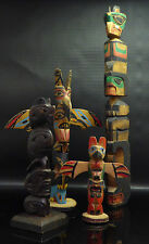 a Collection of Native American Indian North West Coast Wooden Totem Poles