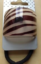 A Brown Zebra Print Curved pony tail band/hair bobble