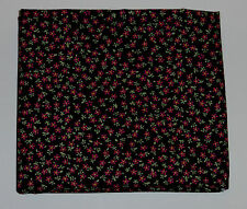 Fabric fat quarter with tiny pink flowers with green leaves on black back ground