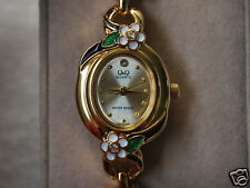 Q&Q by Citizen Gold Tone Lady Dress Watch w/White Flowers
